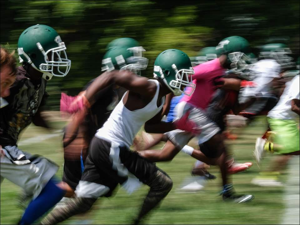 Start High School football players run sprints during the first practice of the season Monday in Toledo.