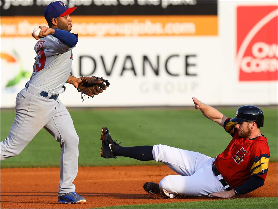 Toledo Mud Hens center fielder Alex Presley is tagged out by Buffalo shortstop Gregorio Petit during the first inning.