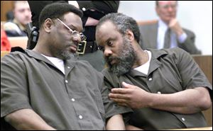Nathaniel and Anthony Cook whisper during their sentencing at Lucas County Courthouse April 6, 2000.